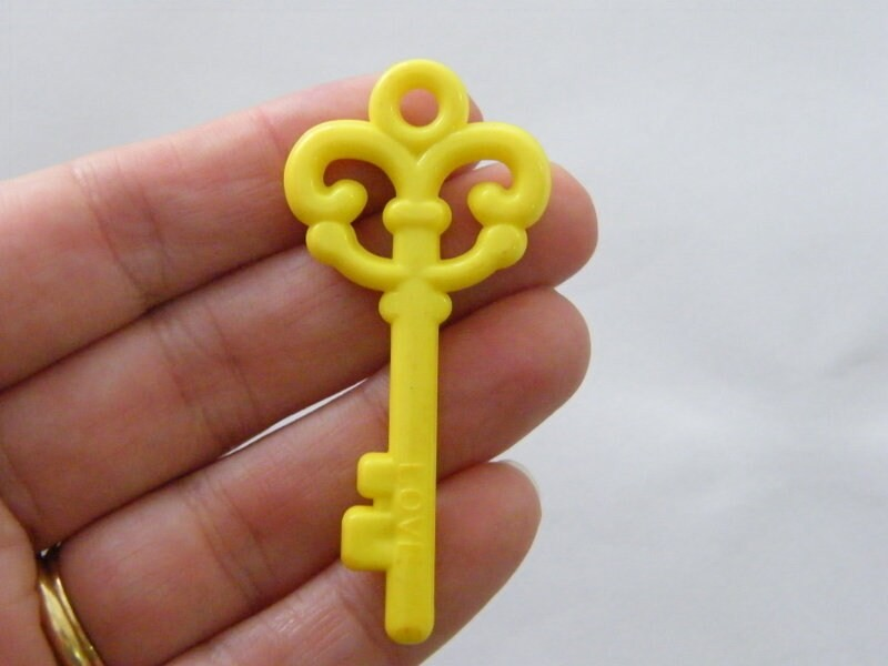 8 Yellow acrylic plastic key pendants