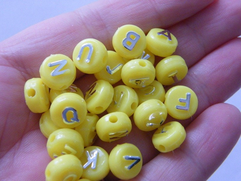 100 Acrylic alphabet 10mm letter yellow and silver RANDOM beads BB462