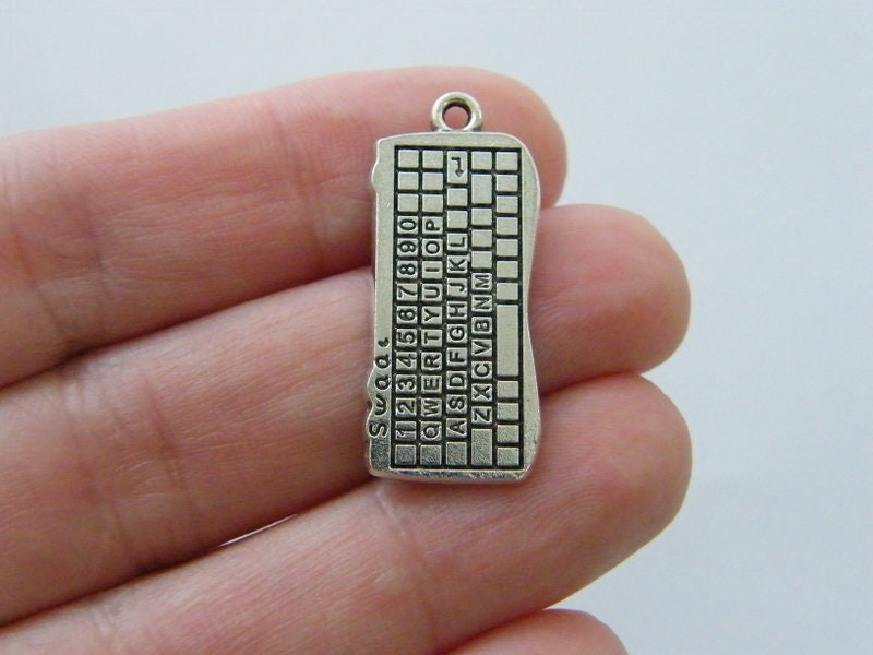 4 Keyboard charms antique silver tone P407