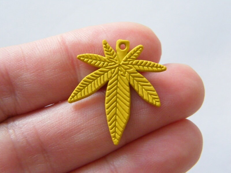 4 Marijuana weed leaf charms yellow tone L127