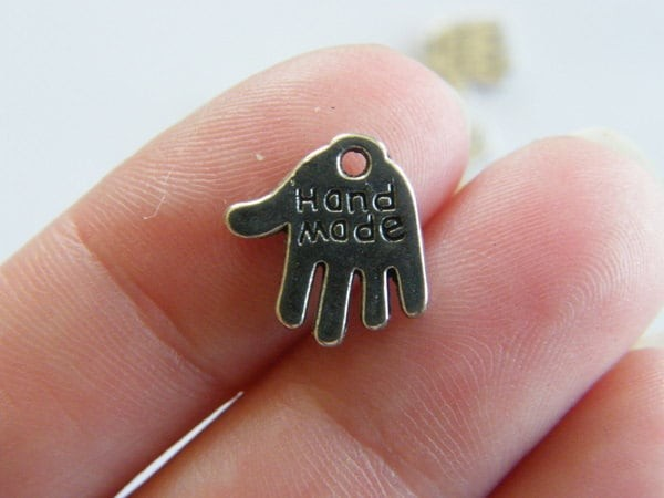 BULK 50 Hand made charms antique silver tone P562
