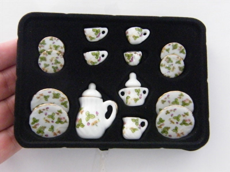 1 White and gold flower and leaves porcelain tea set 03B
