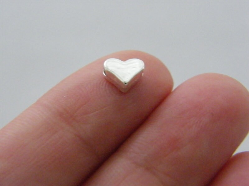 14 Heart spacer beads silver plated tone H56