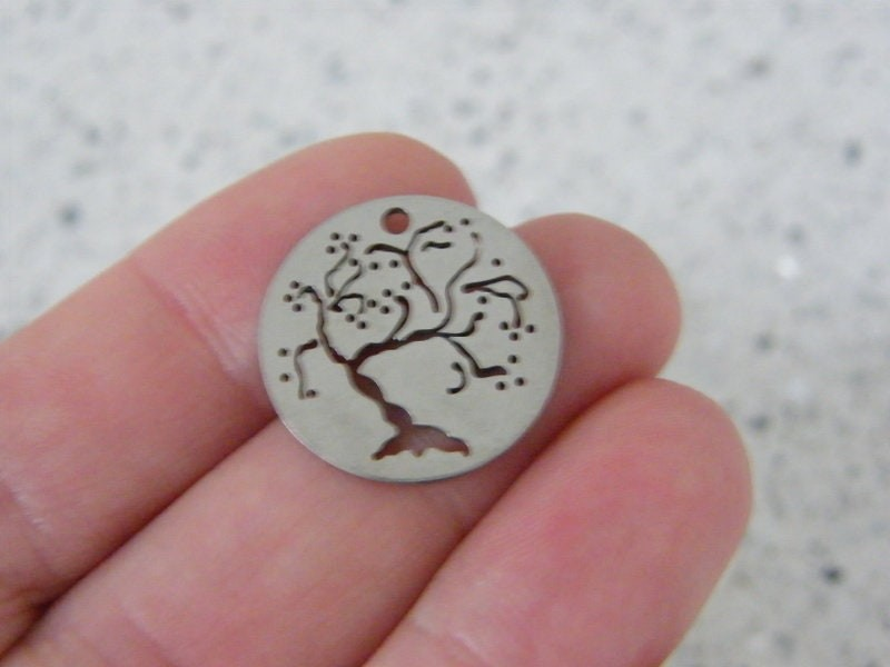 1 Tree cut out pendant silver tone stainless steel T82