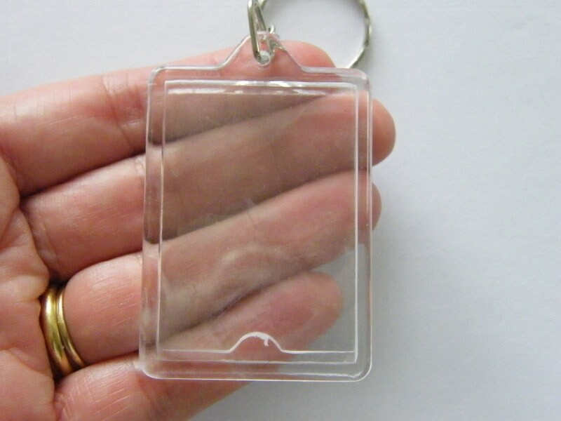 4 Photo frame pendants plastic FS339