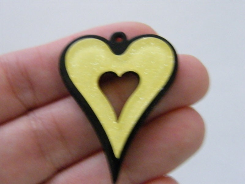 2 Yellow on black glitter powder heart pendants resin H