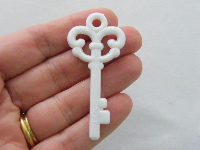 8 White acrylic plastic key pendants