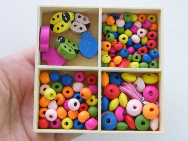 1 Box ladybug and assorted spacer beads wood
