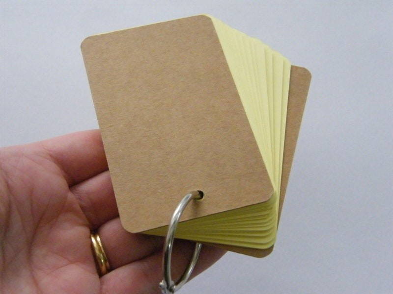1  Yellow note pad cardboard pendant ST2