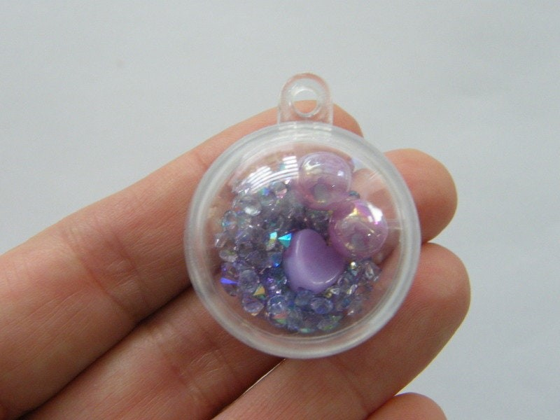 2 Purple can open plastic pendants