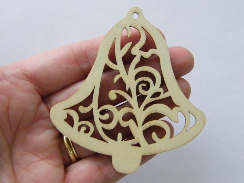 4 Christmas bell pattern pendants wood CT