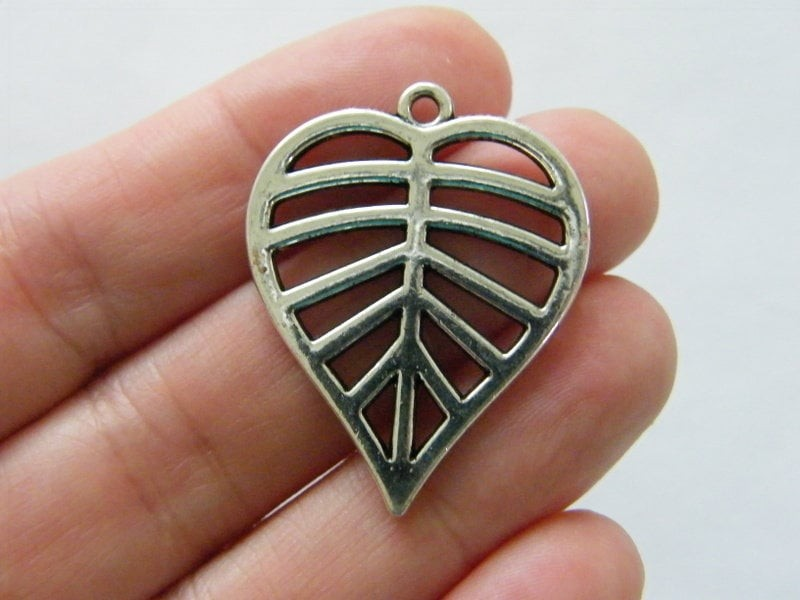 4 Leaf pendants antique silver tone L186