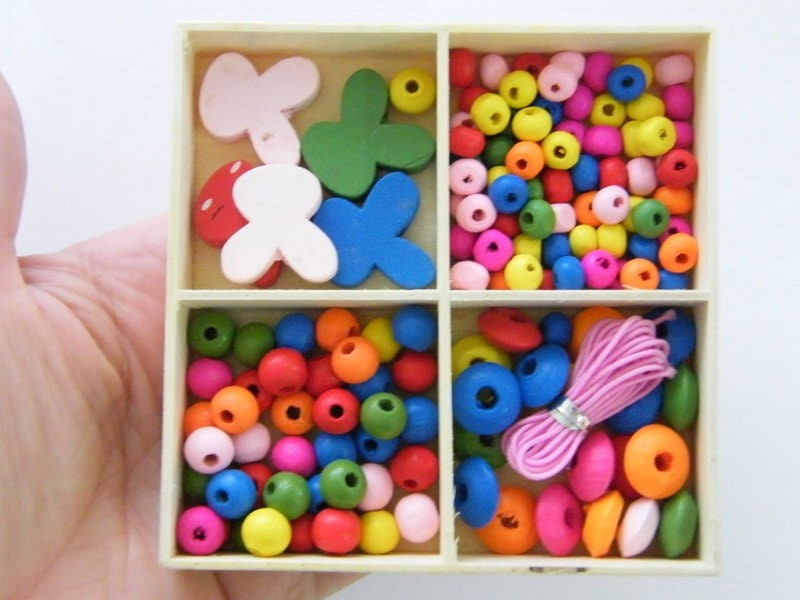 1 Box rabbit and assorted spacer beads wood