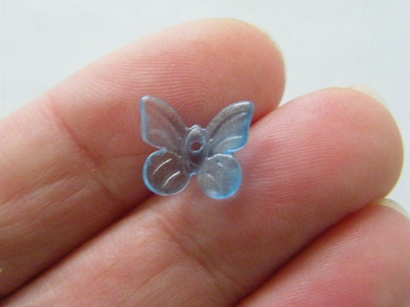 14 Butterfly beads blue glass A906
