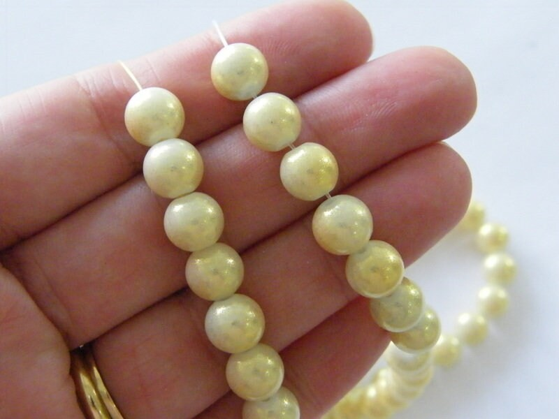 95 Gold and yellow glitter beads glass B186