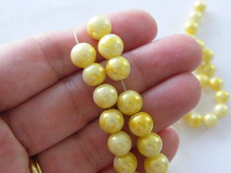 95 Gold and yellow glitter beads glass B187