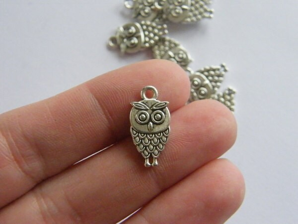 8 Owl charms antique silver tone  B297