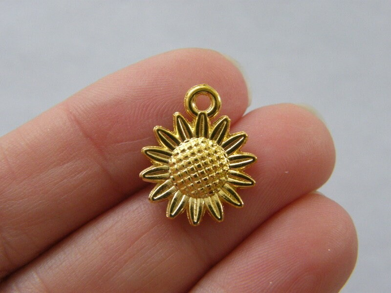 8 Sunflower charms gold tone F146