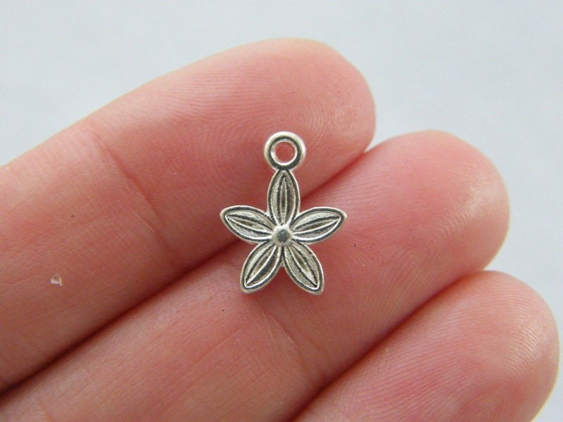 14 Flower  charms  silver plated tone F381