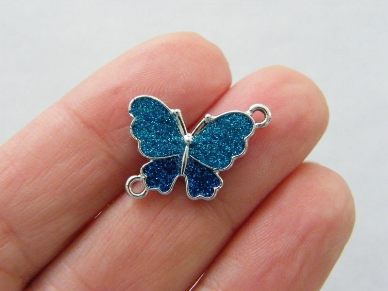 4 Butterfly blue glitter connector charms silver tone A131