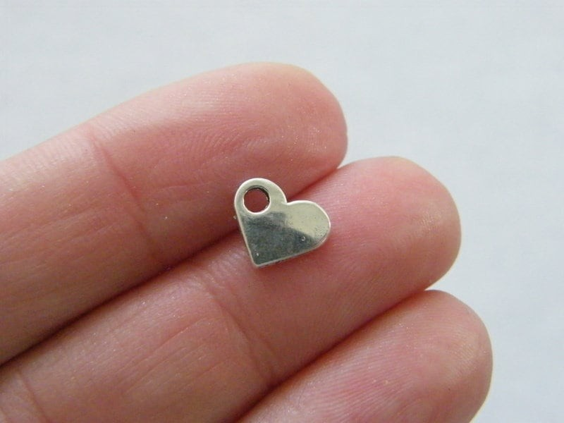 16 Heart charms antique silver tone H62
