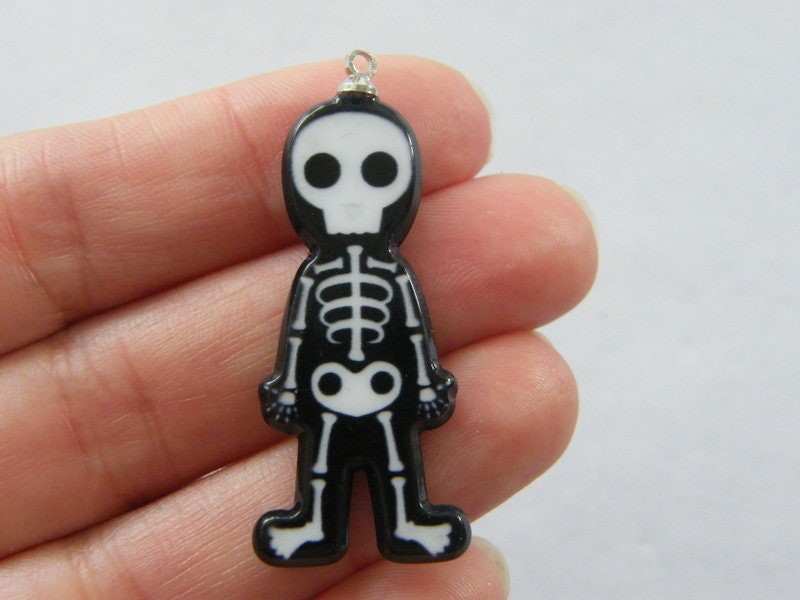 2 Skeleton  charms black white resin HC317