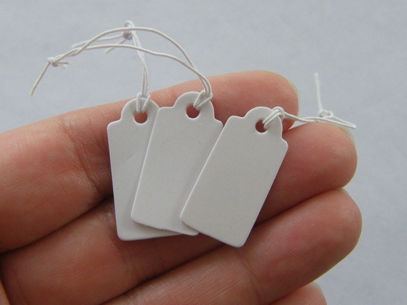 40 White tags elasticated cord  paper T2