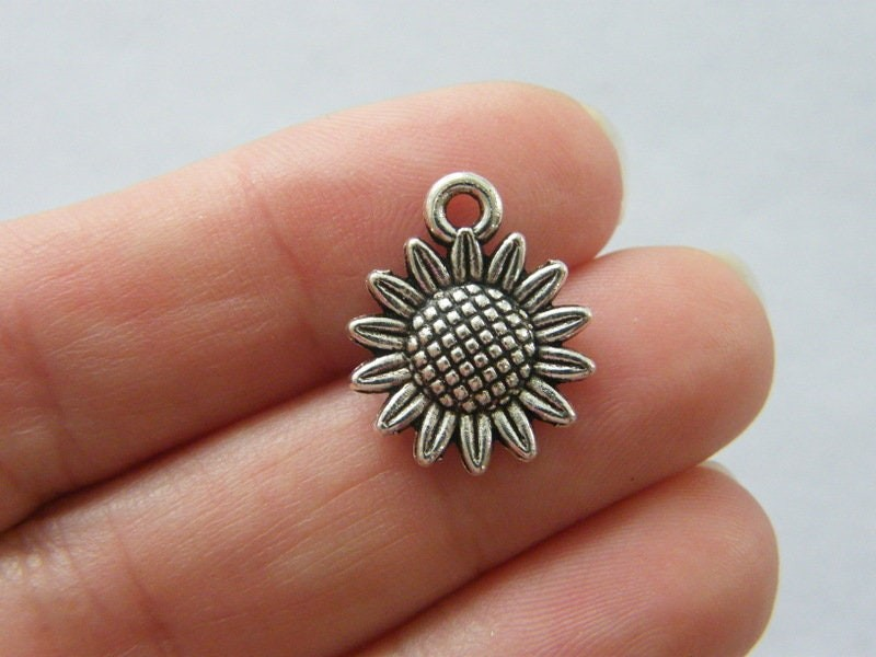 8 Sunflower charms antique silver tone F377