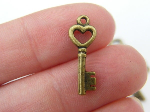 10 Key charms antique bronze  tone K58