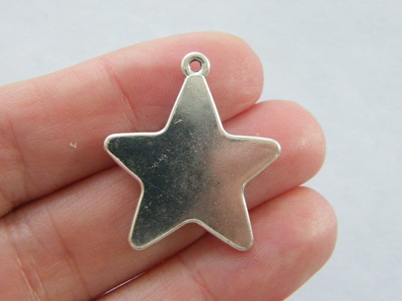 8 Star charms antique silver tone S26