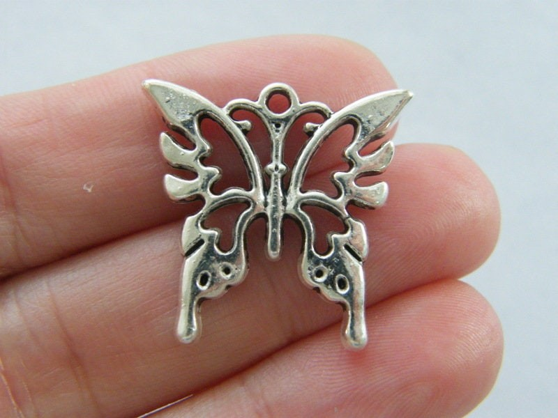 6 Butterfly charms antique silver tone A876