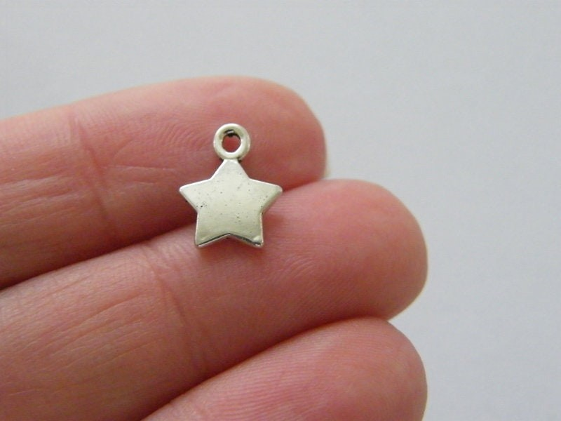 14 Star charms antique silver tone S227