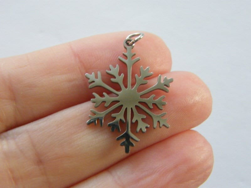 1 Snowflake cut out pendant silver tone stainless steel SF58