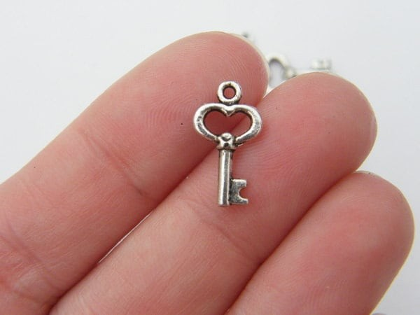 16 Key charms antique silver tone K41