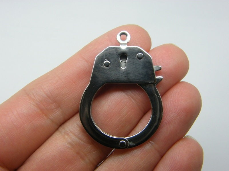 1 Handcuff pendant that opens silver tone stainless steel G10