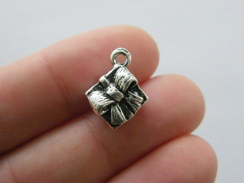 4 Gift or present charms antique silver tone CT