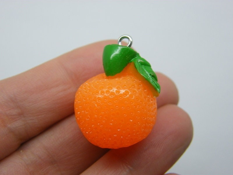 4 Orange fruit pendants resin FD547