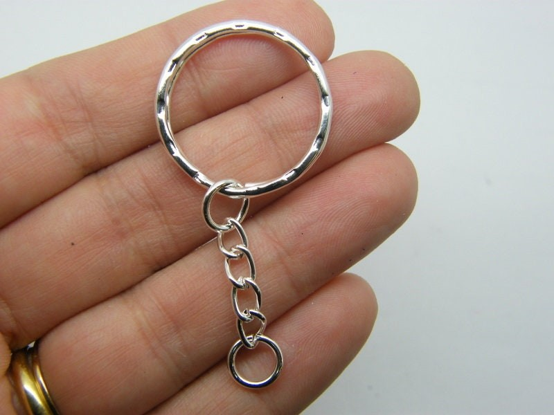 BULK 30 Key ring 55 x 25mm silver plated FS67