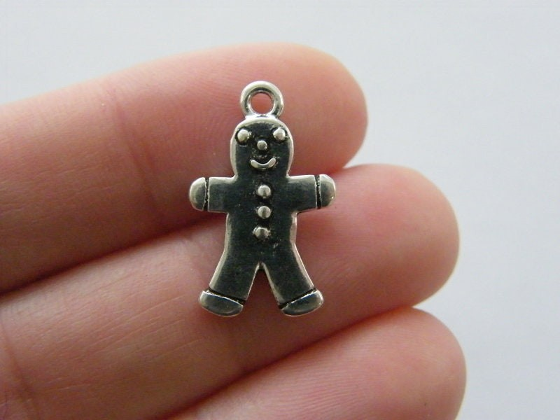 8 Gingerbread man charms antique silver tone CT