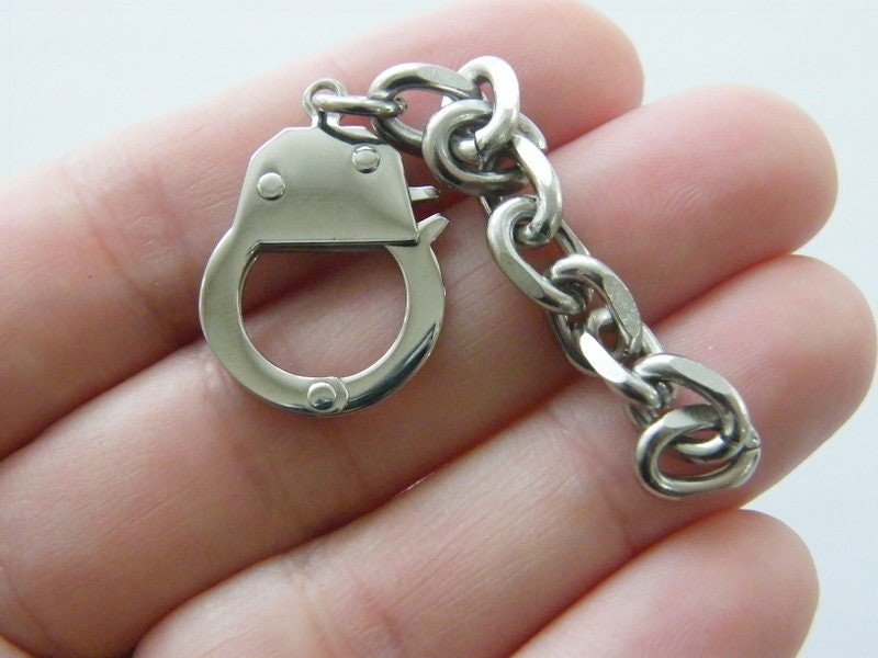 1 Handcuff on a chain pendant silver tone stainless steel G