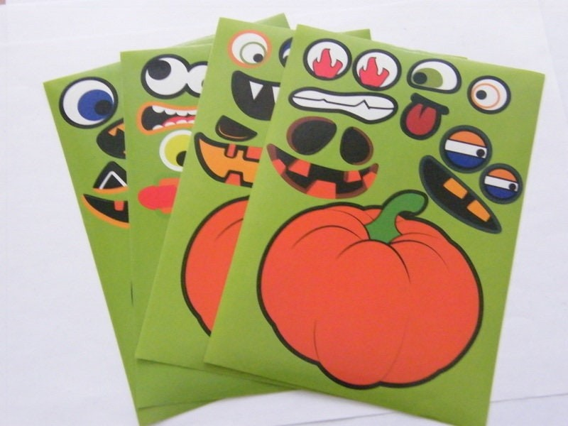 4 Pumpkin face stickers all slightly different
