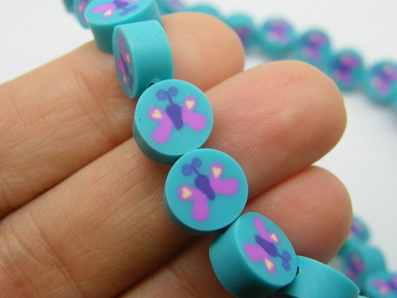 20 Butterfly beads blue pink polymer clay B137