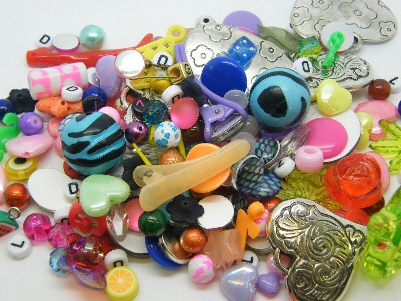 80g Bits and pieces - a random selection of plastic wood and glass charms beads and buttons