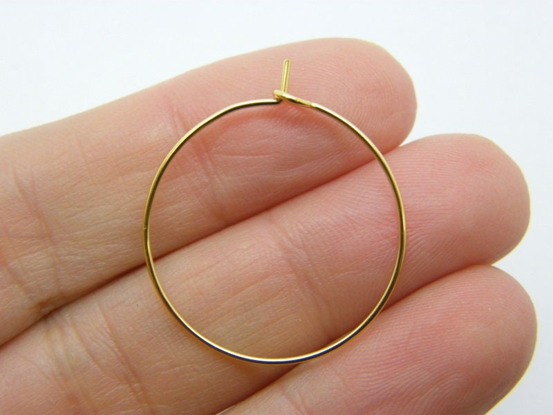 24 Wine hoops 25 x 29mm 01D golden stainless steel FS201