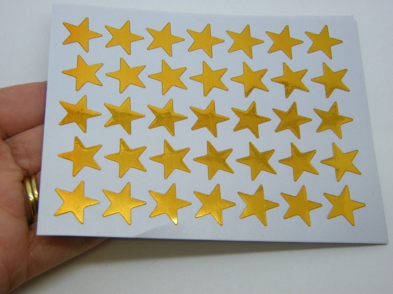 350 Gold star stickers ST