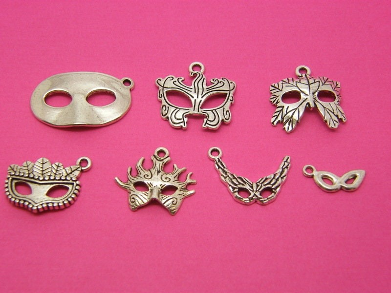 The Mask Collection - 7 different antique silver tone charms