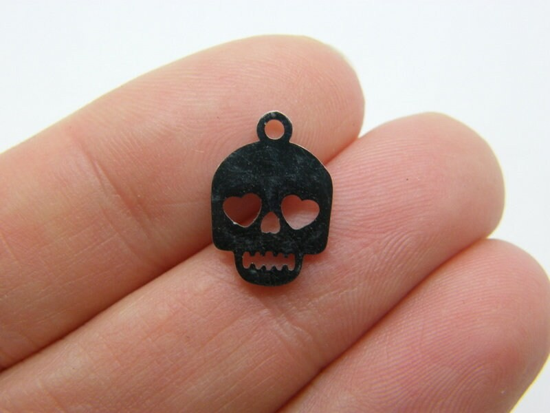 2 Skull heart eyes charms stainless steel HC461