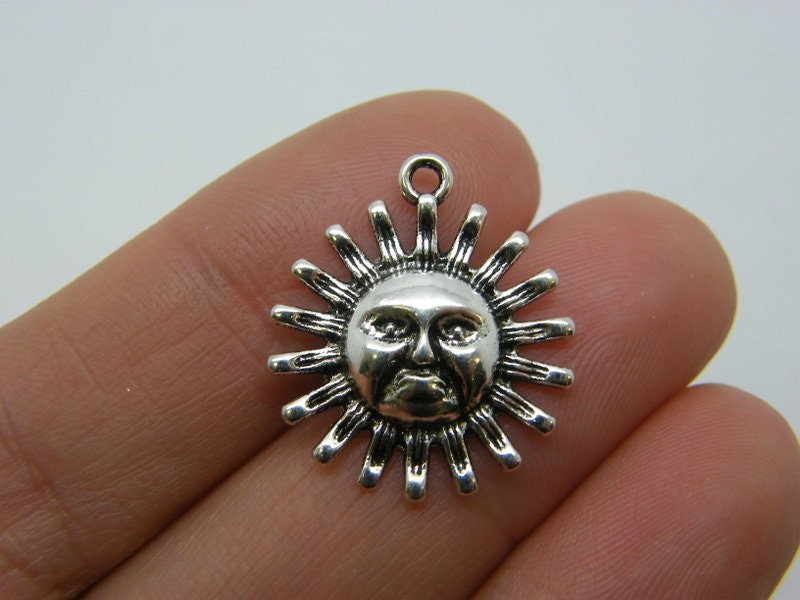 6 Sun charms antique silver tone S252