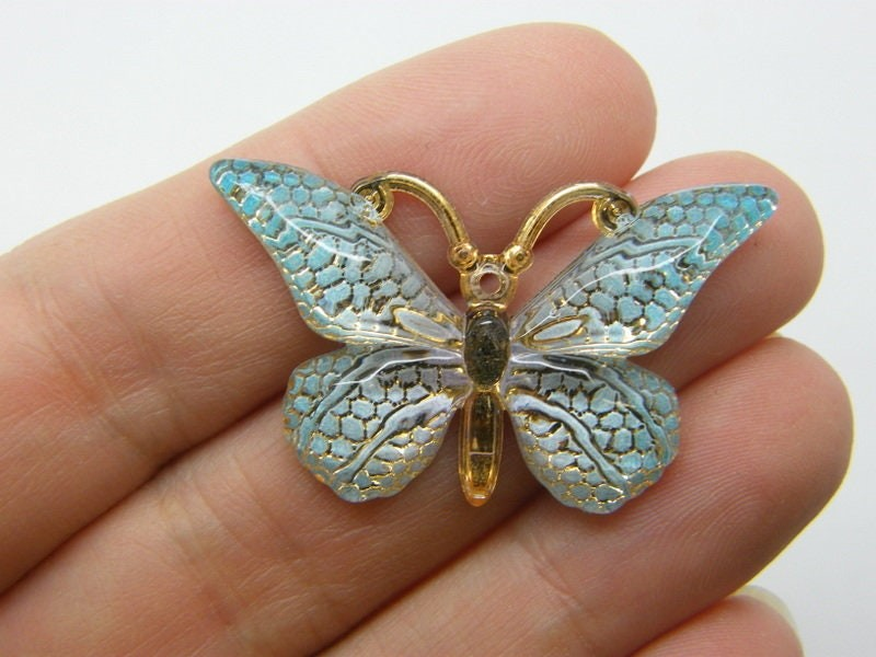 6 Butterfly pendants  blue acrylic A1172