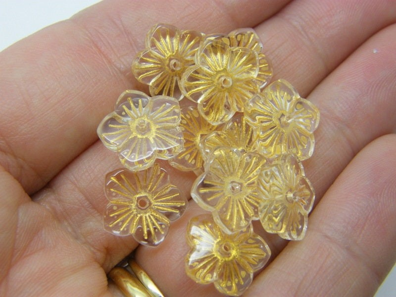 10 Flower  bead cap charms clear yellow glass F476